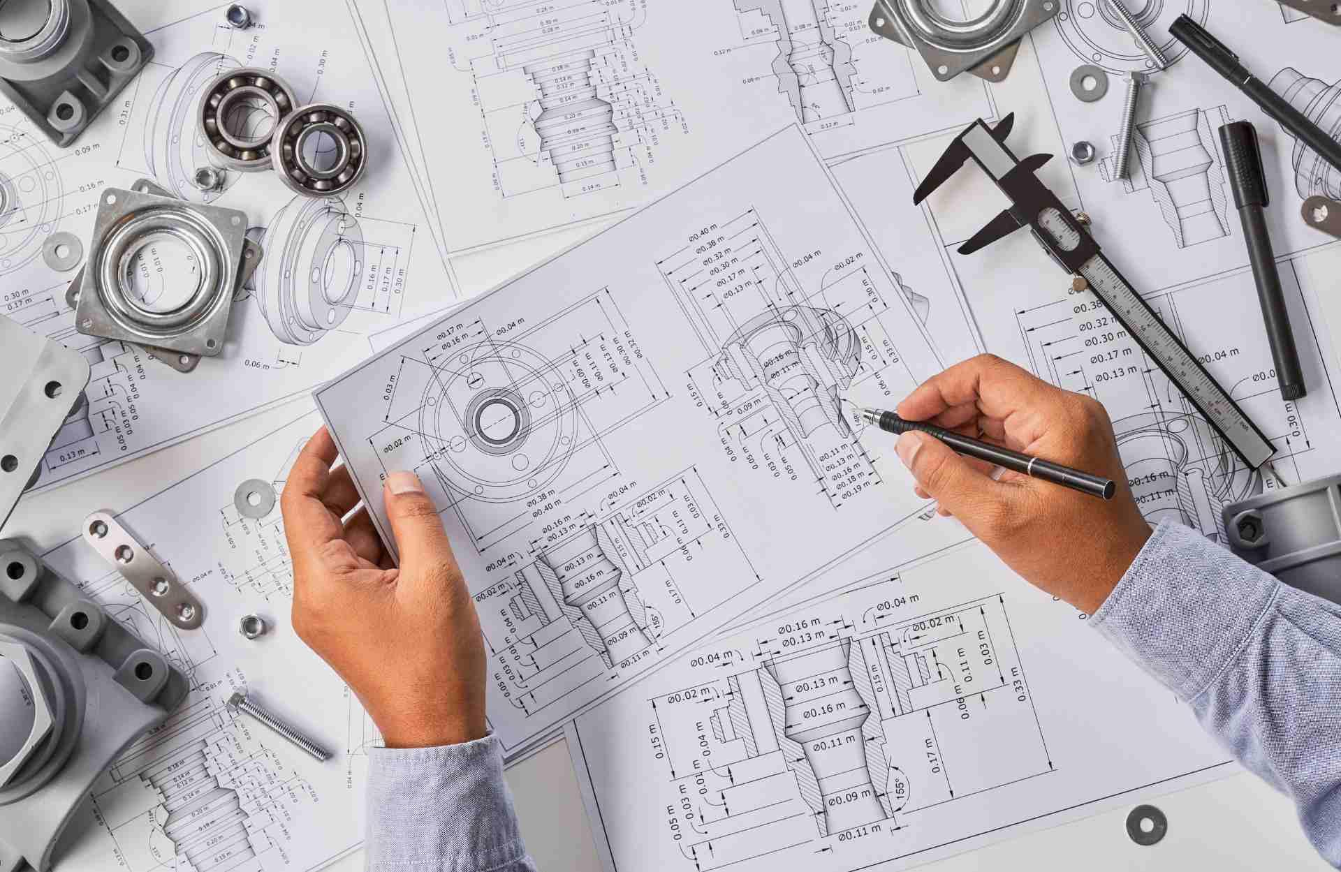 Engineer technician designing drawings mechanicalparts engineering Engine